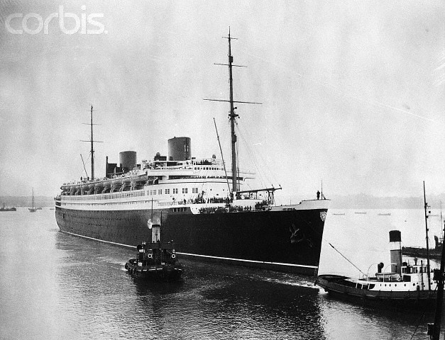"09 Jul 1929, Southampton, England --- 7/9/1929- Southampton, England: The 48,000 ton liner ""Bremen"" pf the North German Lloyd lines arrived at Southahmpton, England to have her hull painted in drydock, one of the only three drydocks capable of holding the giant liner. The other two drydocks are the one in Holland and the other in Hamburg, Germany, when the ""Bremen"" has been painted it will make a short trial trip into the North Sea. View of the ""Bremen"" being towed into the drydock at Southahmpton. --- Image by © Bettmann/CORBIS"