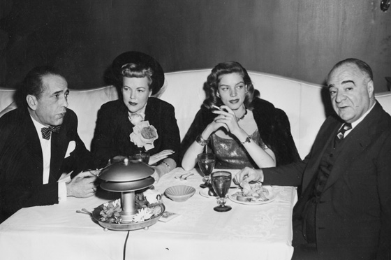 Humphrey Bogart, Lauren Bacall and Ernie Byfield in famous both number 1 - Pump Room, Ambassador East Hotel. www.cruisingthepast.com