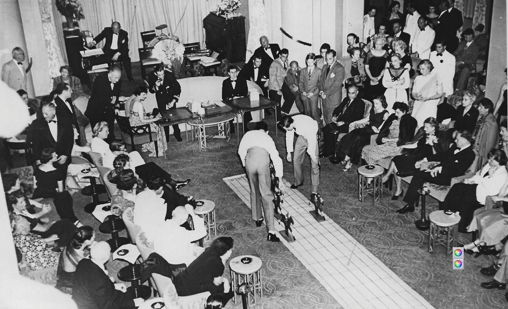 SS America in the 1950s. Horse racing in the First Class Lounge.