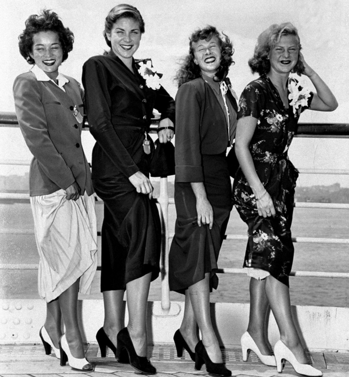 1948 Olympic divers Vicki Dravas, Pat Elsener, Juno Stover and Zoe Ann Olsen (l. to r.) smile aboard the liner S. S. America before sailing for Olympics in London.