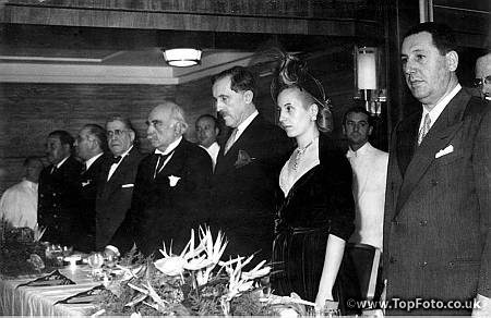 "Eva Peron (Evita) with the British Ambassador, Sir John Balfour at a reception aboard the steamship ""Eva Peron"", to mark the arrival in Buenos Aires of the ship at the end of its maiden voyage from England. June 1950."