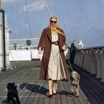 Grace Kelly (Princess Grace) walks her dogs on the SS Constitution.