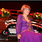 "Rosa Rio, 103, at the Tampa Theatre Wurlitzer following her performance for the silent film ""Beyond the Rocks"" at the ATOS National Convention in May 2006."