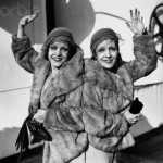Famous Siamese twins, Violet, left, and Daisy Hilton of Texas, pictured aboard the S.S. Aquitania upon return from a theatrical performance in England.
