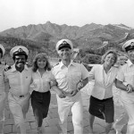 "Fred Grandy (left) followed his tour of duty on ""The Love Boat"" by going into politics. He and cast members walk hand in hand, May 30, 1983, at the Great Wall near Beijing, China. From left to right: Grandy, Ted Lange, Jill Whalen, Gavin MacLeod, Lauren Tewes and Bernie Kopell. (AP Photo/Liu Heung Shing)"