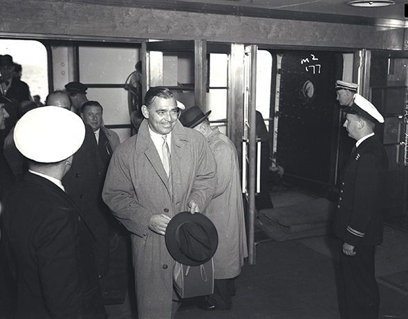 Clark Gable coming aboard one of the Queens...