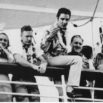 Elvis waving to fans as he sails away from Honolulu on the SS Lurline... 1957