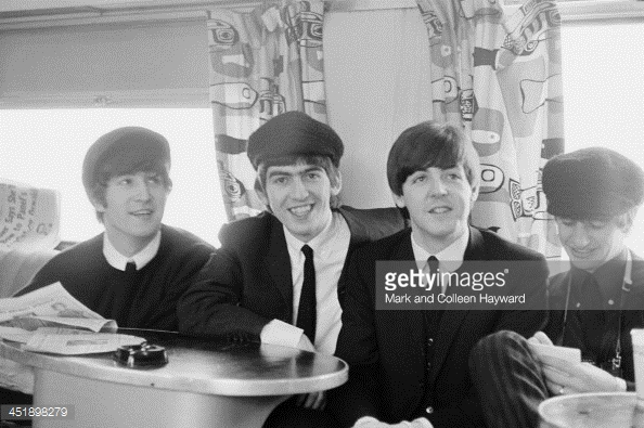The Beatles aboard the Congressional Limited from New York to Washinton... in 1964...