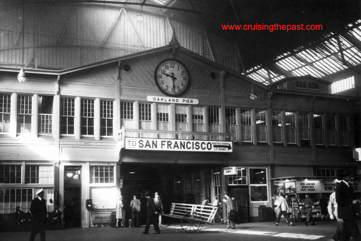 The head house at the west end of Oakland Pier with its giant clock about 1950. By this time, with over seven decades of service, countless millions of travelers had passed this way between the trains and ferries.